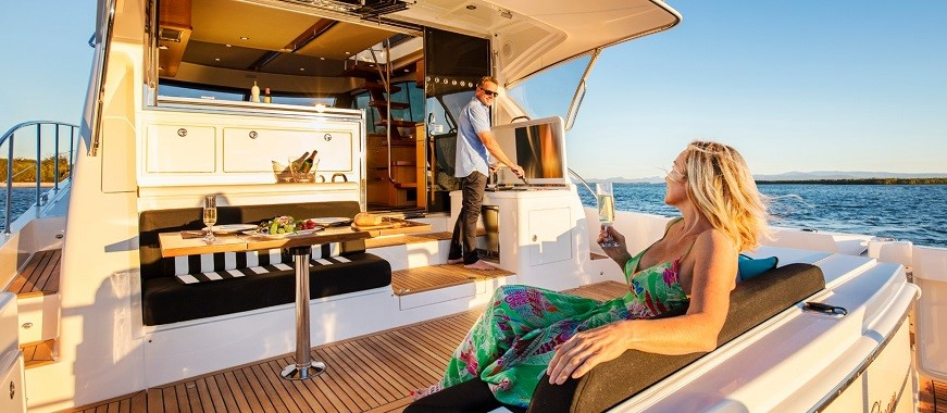 Owners enjoying the new Riviera 52 Enclosed Flybridge for Sale